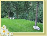 The Wilderness Gateway Bed and Breakfast guest lawn in the summer